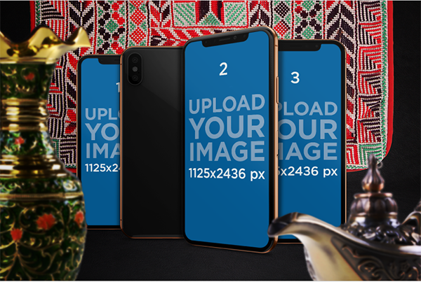 Mockup featuring three iphones x in an arabic inspired setting