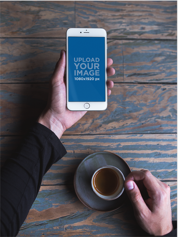 Mockup of a man holding a silver iphone 8 plus and an espresso