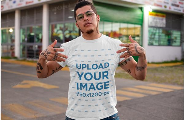 T-Shirt Mockup of a Tattooed Man Showing